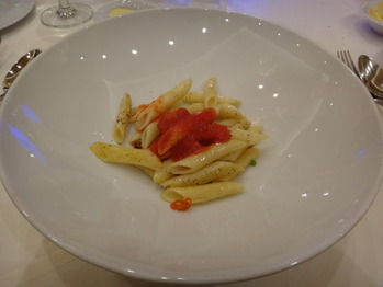 PENNE PASTA WITH GARLIC PRAWNS,CUT CHILI AND TOMATO CONCASSE