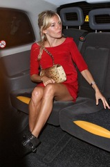 Sienna Miller in red dress leaving Wolseley Restaurant 08