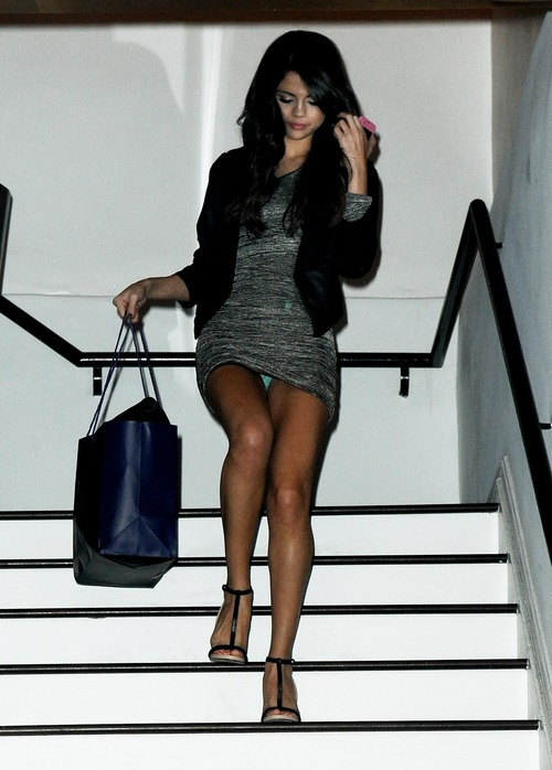 Selena Gomez - upskirt leaving a salon (1)