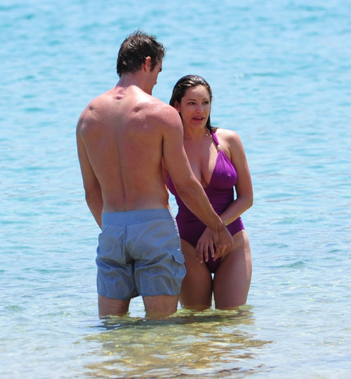 Kelly Brook in purple swimsuit on holiday (6)
