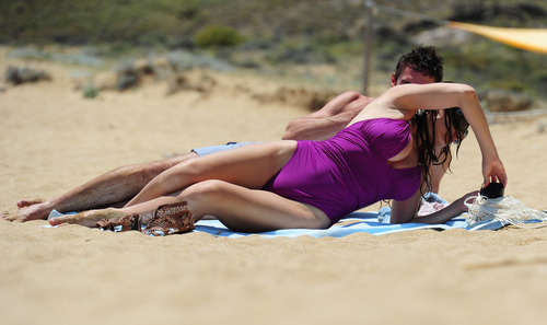 Kelly Brook in purple swimsuit on holiday (14)