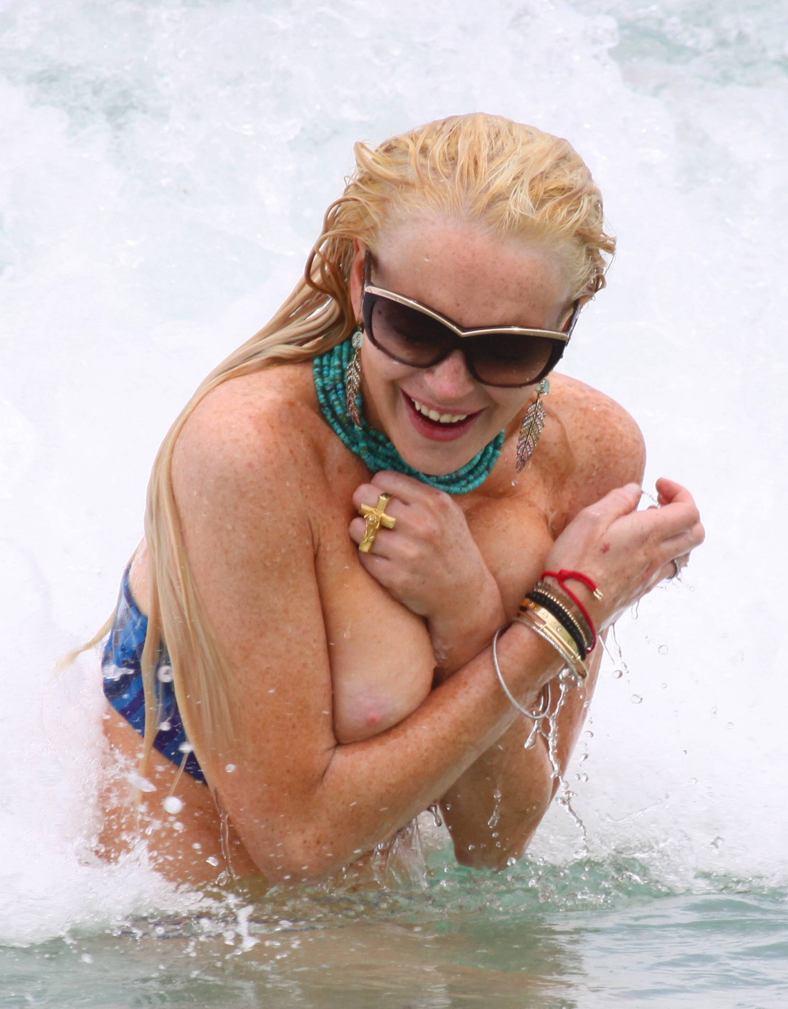 Lindsay Lohan - In Bikini on Miami Beach BOOB Slip