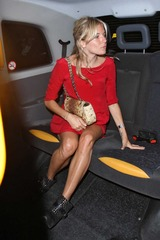 Sienna Miller in red dress leaving Wolseley Restaurant 05