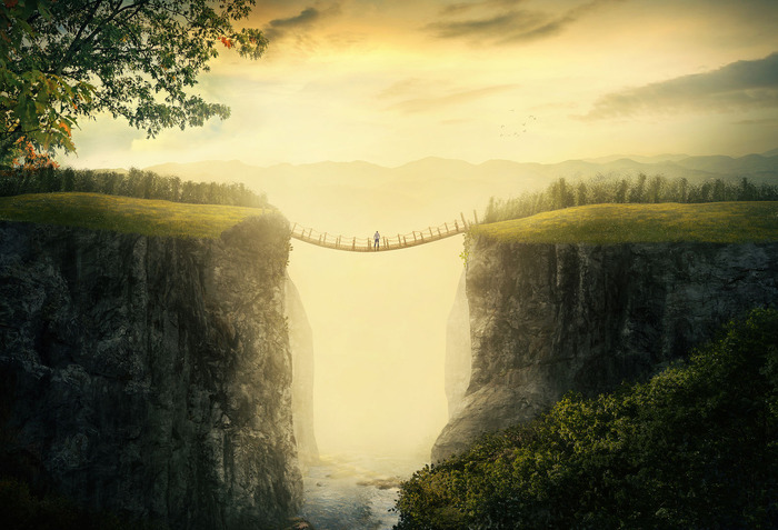 a-man-stands-alone-on-a-bridge-between-two-mountains_HX4-pR-l0