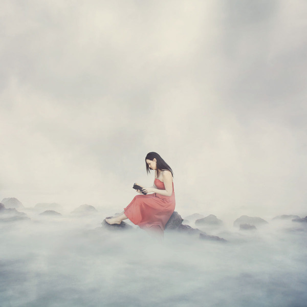 woman-alone-on-top-of-the-clouds-reading-her-bible_HQgiQyfx0