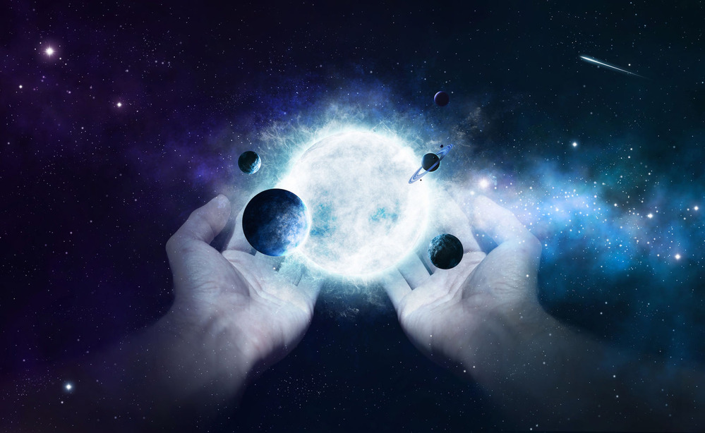 two-hands-holding-the-sun-and-planets-in-the-universe_S7OKzkGeC