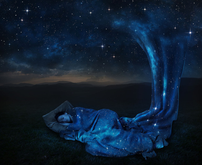 a-woman-sleeps-under-a-blanket-made-of-stars_SmtZT0WgA