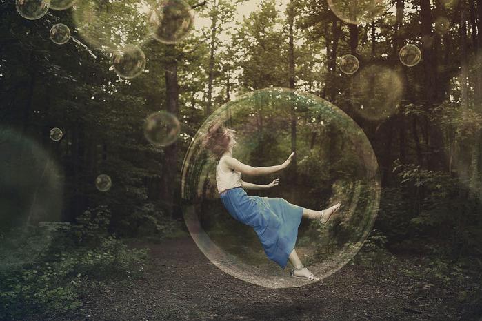 a-woman-is-falling-and-stuck-inside-a-bubble_SmK-QkMgC