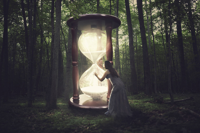 a-woman-finds-a-huge-hourglass-in-the-forest_rmP30WgA