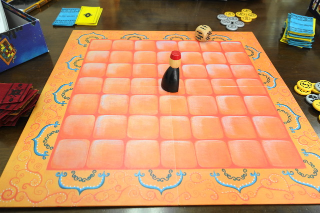 中央ボードの真ん中にオッサン駒が1つ置かれている