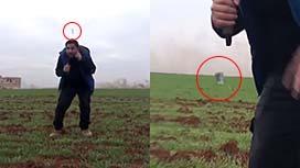 空爆で直ぐ近くに落ちた爆弾が不発弾だったため助かったレポーターの映像