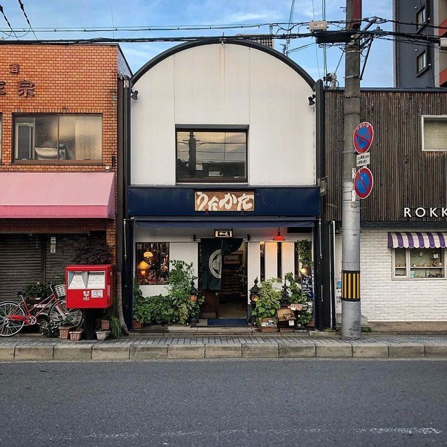 Man-still-enamoured-by-Kyotos-Small-Buildings-5be9428076105__880