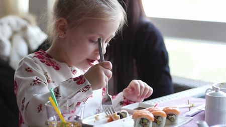 little-girl-eats-sushi-with-a-fork_sn732jkgl_thumbnail-full01