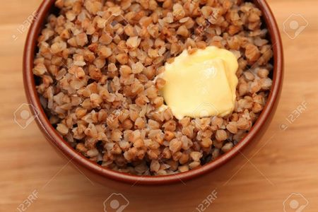 41964478-cooked-buckwheat-with-butter-in-bowl-close-up-