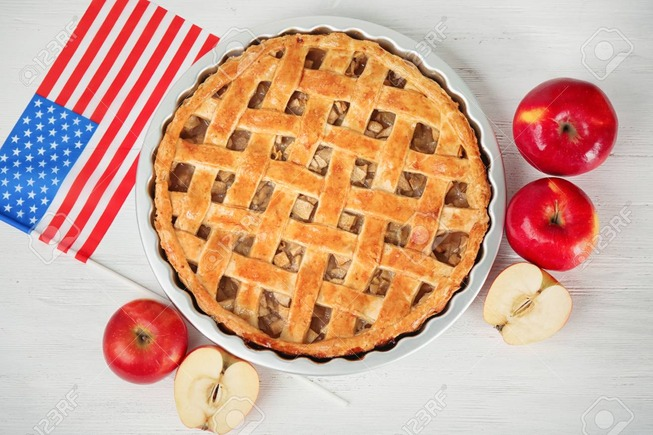 99477748-delicious-american-apple-pie-with-flag-on-table