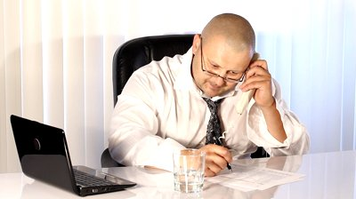 stock-footage-tired-businessman-talking-on-the-phone