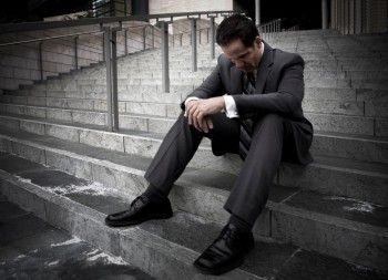 Sad-man-on-steps-350x253