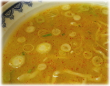 龍上海 赤湯からみそラーメンの味噌を混ぜた後のスープ
