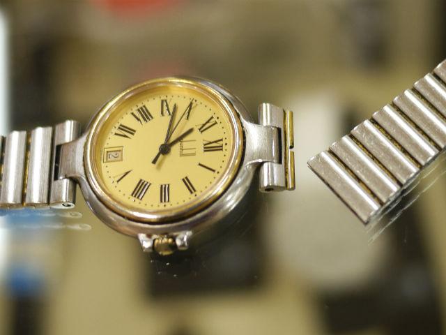 金属バンドが破損したダンヒル(dunhill)ミレニアム腕時計