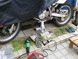 (1)修理スタンドへ
