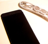 Apple's included iPod sleeves go from gray to black
