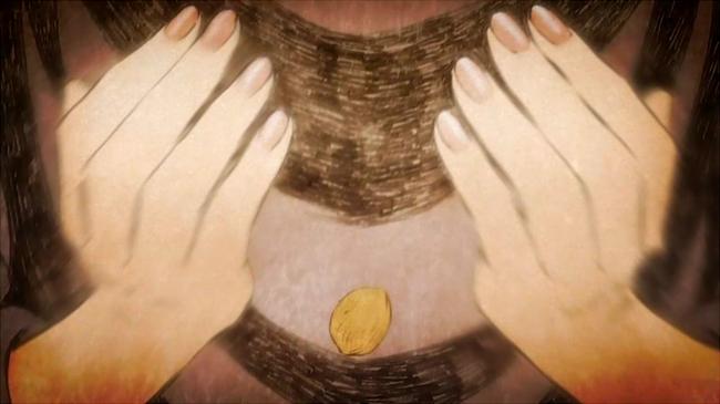 女性の手から落とされるクルミ