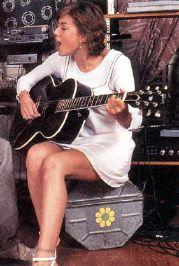 Kari Wuhrer guitar