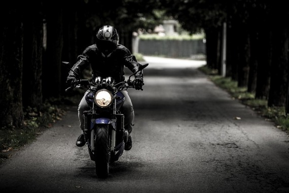 man-riding-motorcycle-on-road