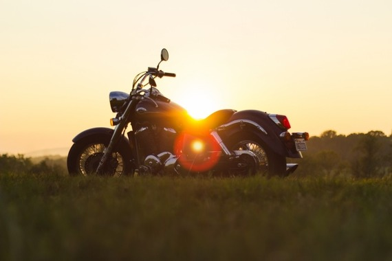 motorcycle-in-meadow-at-sunset
