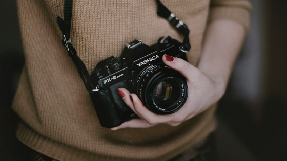 woman-with-vintage-camera