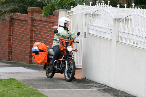 Postie_on_motorbike_-_chadstone