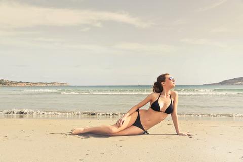 woman-in-black-bikini-on-seashore-825776