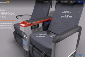 SQ-Premium-Economy-Seat-Width-Storage