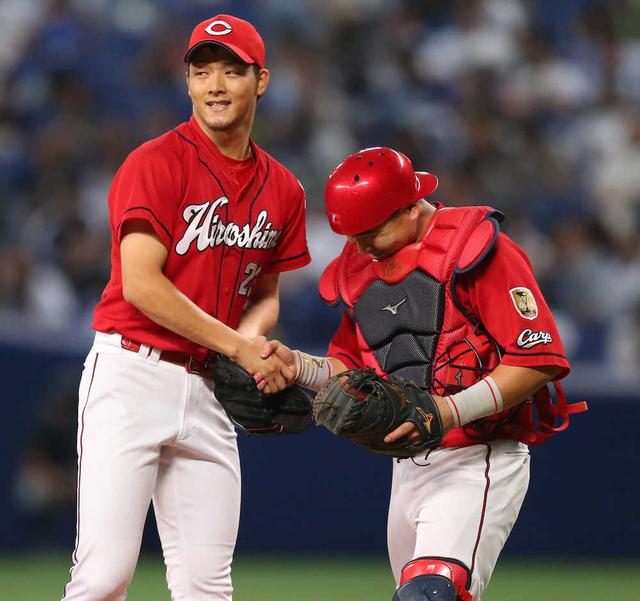 薮田和樹會澤翼握手