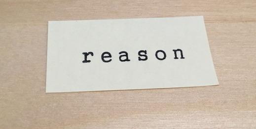 理由と書かれた紙