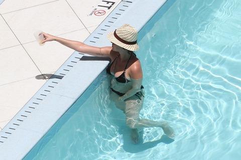 Katy Perry - wearing a bikini at a hotel pool in Miami  13