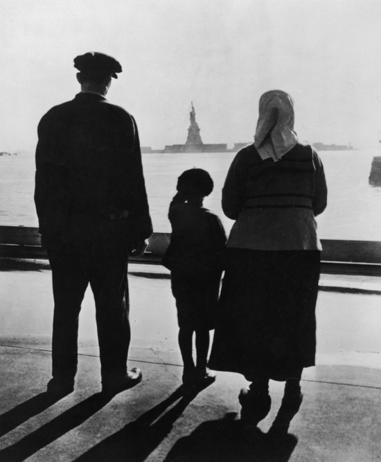 n-REAR-VIEW-OF-AN-IMMIGRANT-FAMILY-ON-ELLIS-ISLAND-L-570