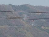 働くヘリコプター消火剤散布?