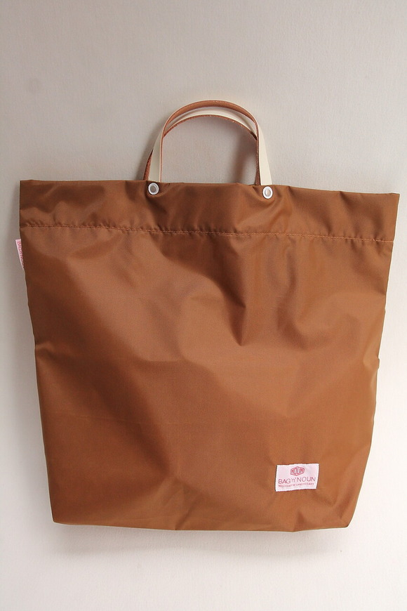 BAG n NOUN Nylon Pack BROWN
