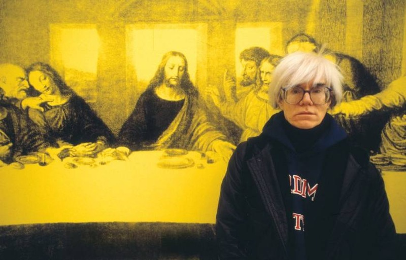 Andy Warhol in front of a version of The Last Supper