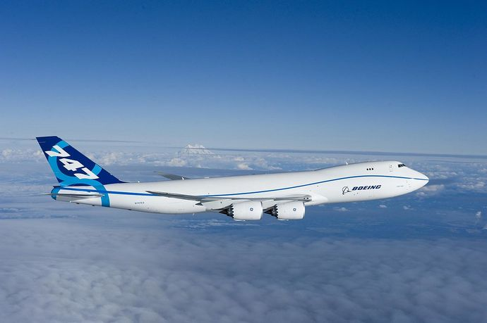 1280px-Boeing_747-8_first_flight_Everett,_WA