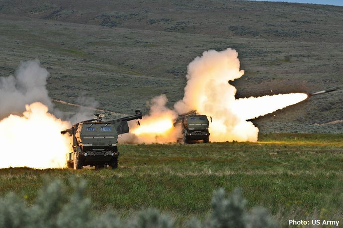 1280px-Firing_High_Mobility_Artillery_Rocket_systems