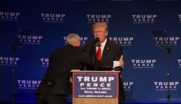 161105211328-01-trump-rushed-off-stage-1105-exlarge-169