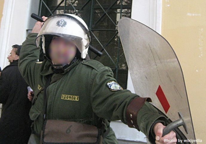 Greek_riot_police_reverse_baton_masked_12-3-07