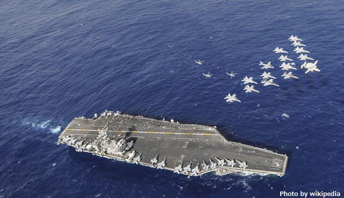CVW-11_aircraft_over_USS_Nimitz_(CVN-68)_in_2013