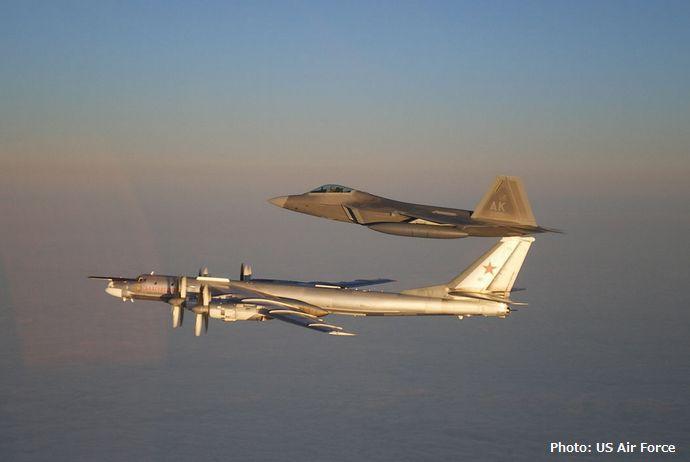 russian-tu-95-bear-usaf-f-22-raptor-071122-f-zy202-005