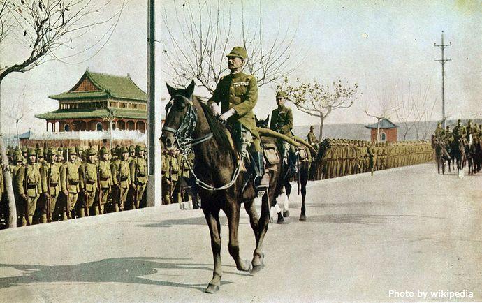 1024px-Iwane_Matui_and_Asakanomiya_on_Parade_of_Nanking
