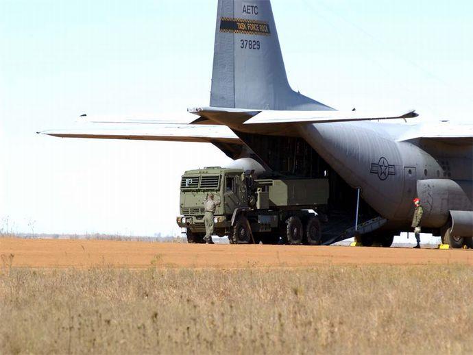 HIMARS_rolls_off_a_C-130