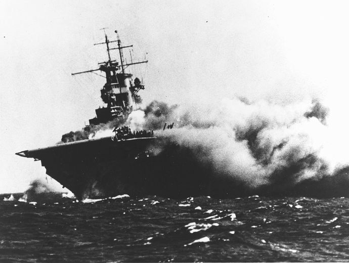 1280px-USS_Wasp_(CV-7)_burning_on_15_September_1942_(80-G-16331)