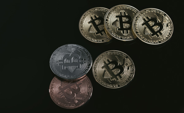 ビットコイン、処理速度向上で一致、規格分裂回避